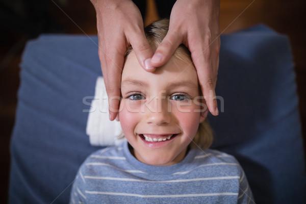 мнение улыбаясь мальчика голову массаж женщины Сток-фото © wavebreak_media