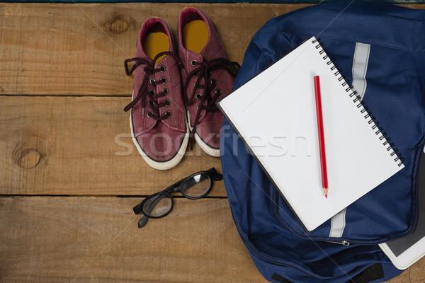 Sapatos óculos livro lápis digital comprimido Foto stock © wavebreak_media
