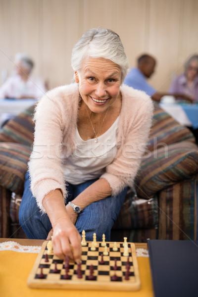 Portré idős nő játszik sakk asztal Stock fotó © wavebreak_media