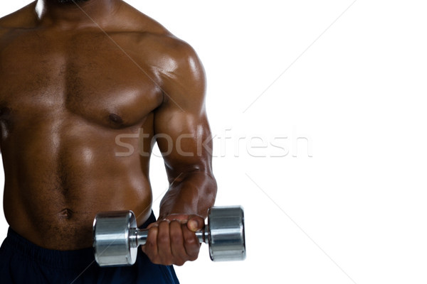 Mid section of muscular sportsman exercising with dumbbells Stock photo © wavebreak_media