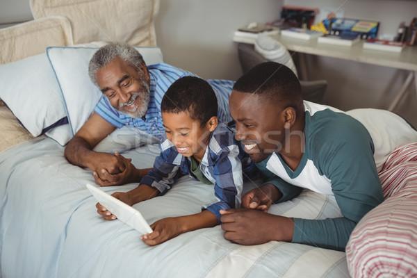 Multi-generation family using digital tablet on bed Stock photo © wavebreak_media