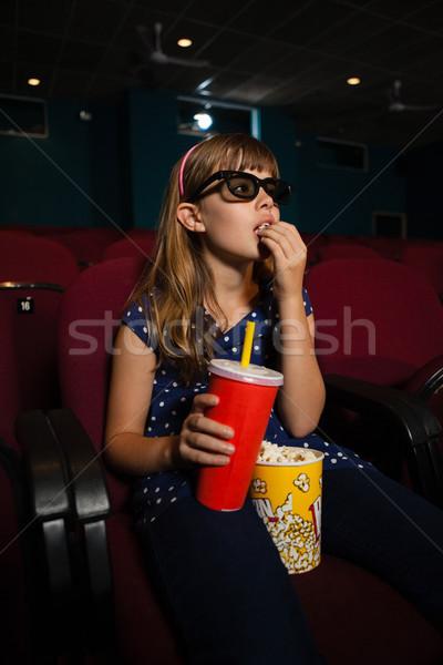 Lány visel 3d szemüveg eszik pattogatott kukorica film Stock fotó © wavebreak_media