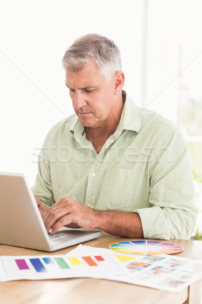 Attentive businessman working on a laptop Stock photo © wavebreak_media