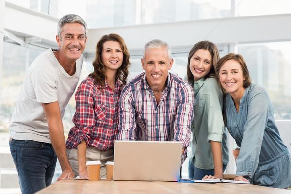 Beş gündelik arkadaşları dizüstü bilgisayar kullanıyorsanız ofis adam Stok fotoğraf © wavebreak_media