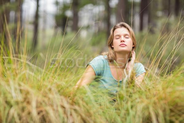 молодые довольно турист сидят высокий трава Сток-фото © wavebreak_media
