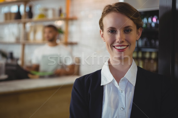 Portrait of happy owner with waiter in background at cafe Stock photo © wavebreak_media