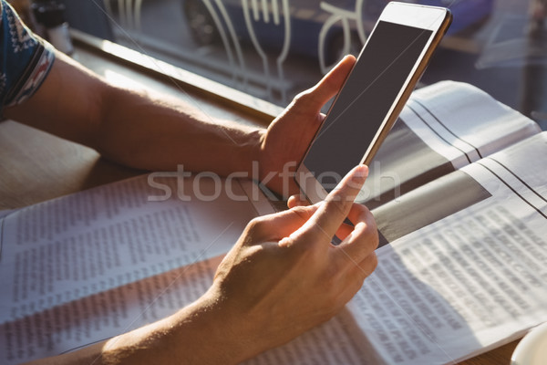 Cropped hands of man with newspaper holding tablet in cafe Stock photo © wavebreak_media