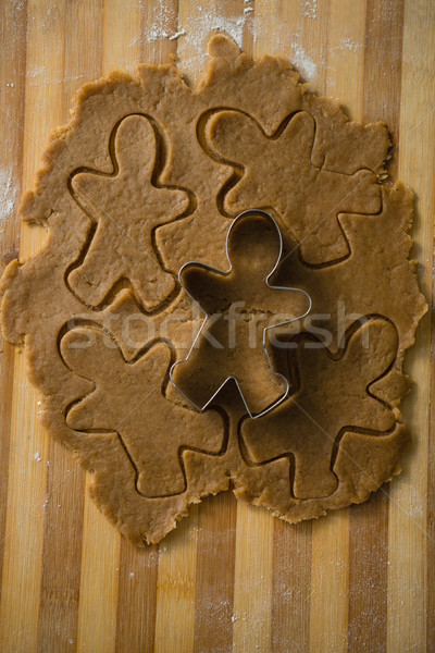 Close up of gingerbread man pastry cutter on dough Stock photo © wavebreak_media