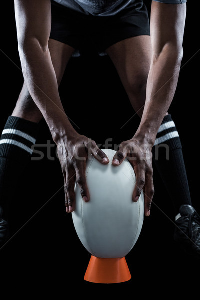 Mid section of rugby player keeping ball on kicking tee Stock photo © wavebreak_media
