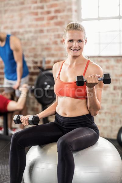 Gespierd glimlachende vrouw gewichtheffen crossfit gymnasium man Stockfoto © wavebreak_media