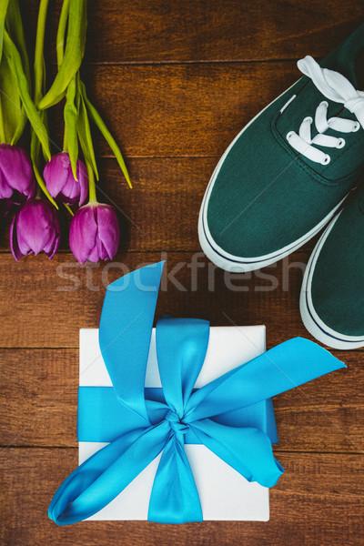 Kilátás sportcipők kék ajándék közelkép virág Stock fotó © wavebreak_media