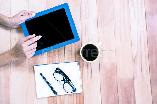 Overhead of feminine hands using tablet Stock photo © wavebreak_media