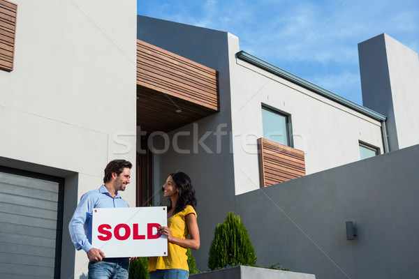 Happy couple in front of new house Stock photo © wavebreak_media