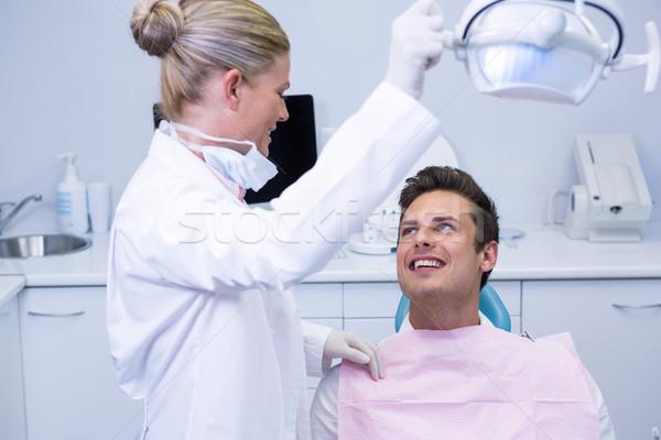 Dentista eléctrica luz paciente sesión silla Foto stock © wavebreak_media