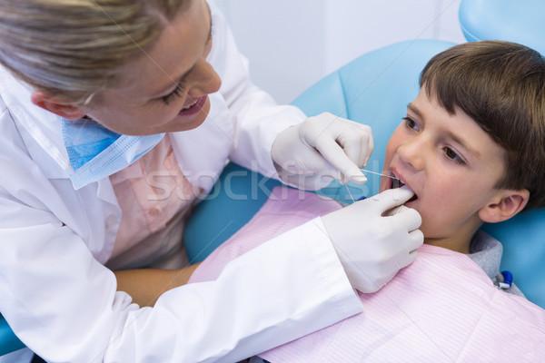 Female doctor examing boy mouth Stock photo © wavebreak_media