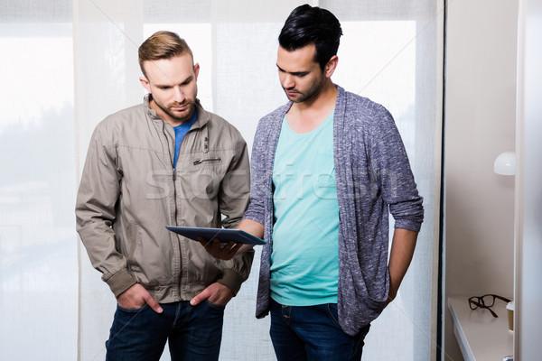 Odaklı eşcinsel çift bakıyor tablet ev Stok fotoğraf © wavebreak_media