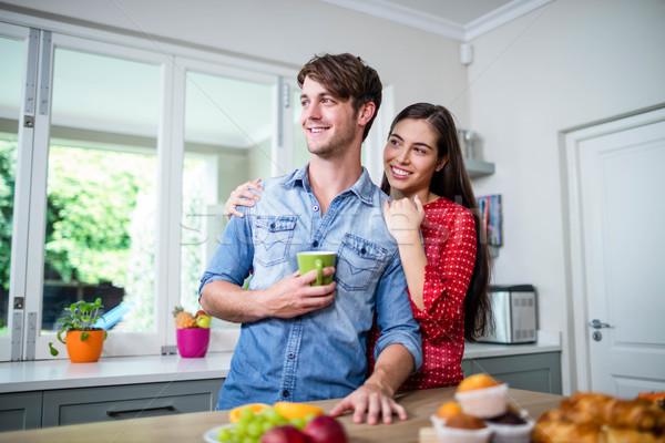 Happy couple having breakfast together Stock photo © wavebreak_media