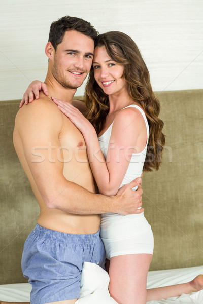 Portrait of young couple embracing on bed Stock photo © wavebreak_media