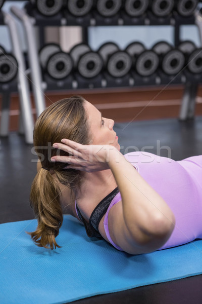 Woman doing abdominal crunches on mat Stock photo © wavebreak_media
