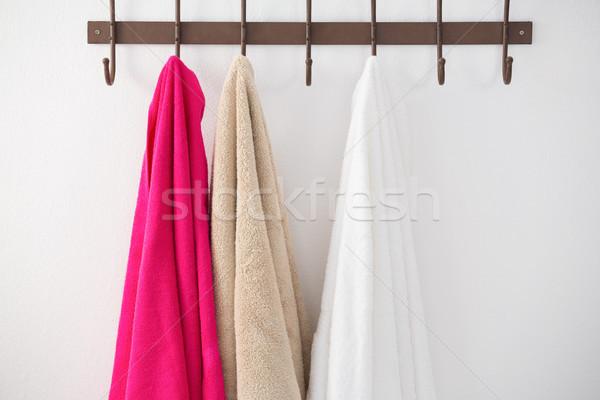 Colorful towels hanging on hook Stock photo © wavebreak_media