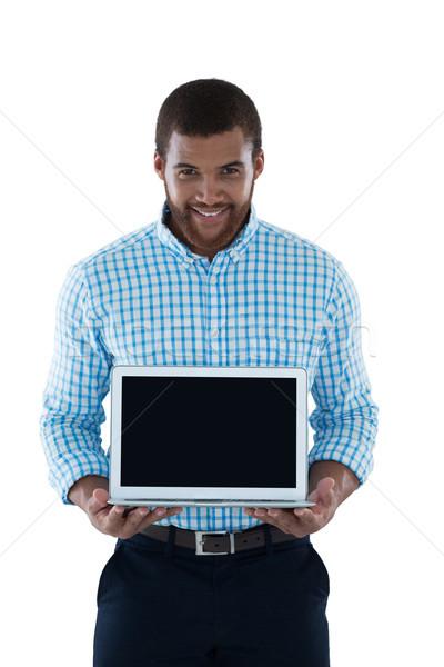 Male executive holding laptop Stock photo © wavebreak_media