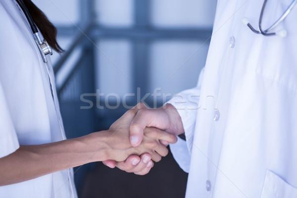 Mid section of doctors shaking hands Stock photo © wavebreak_media