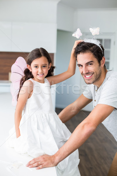 Portrait of smiling father with butterfly headband and daughter  Stock photo © wavebreak_media