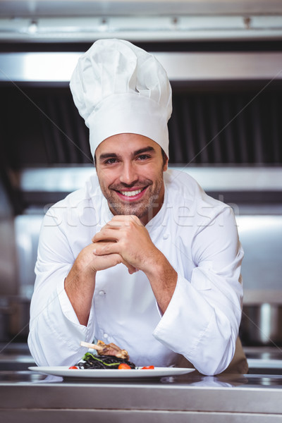 Chef leaning on the counter with a dish Stock photo © wavebreak_media