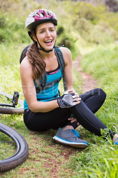 Woman hurting her leg Stock photo © wavebreak_media