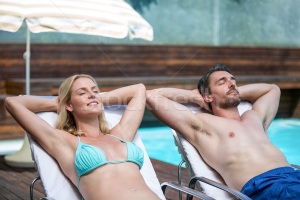 Casal relaxante sol mulher piscina estância termal Foto stock © wavebreak_media