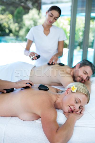 Quente pedra massagem massagista Foto stock © wavebreak_media