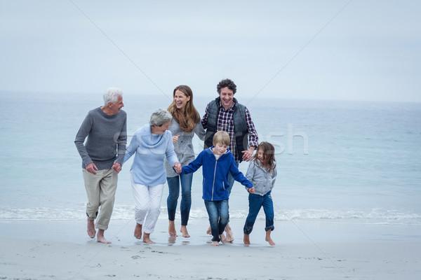 Mutlu aile deniz kıyı tam uzunlukta Stok fotoğraf © wavebreak_media
