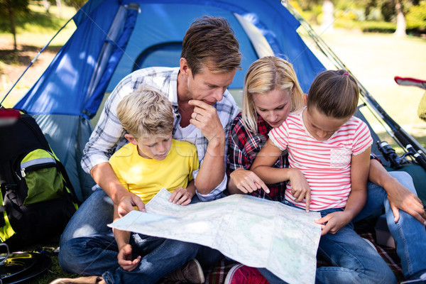 Stock photo: Family looking at a map