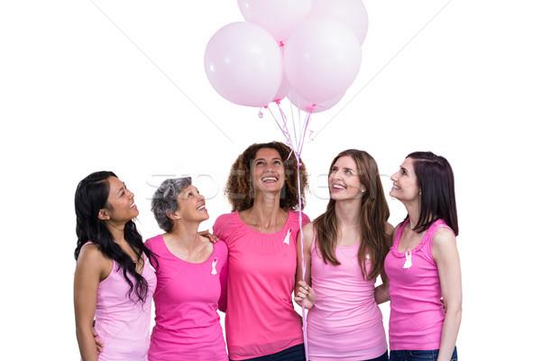 улыбаясь женщины розовый позируют шаров груди Сток-фото © wavebreak_media