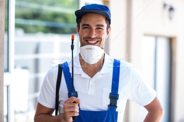 Portrait of happy worker with crop sprayer Stock photo © wavebreak_media
