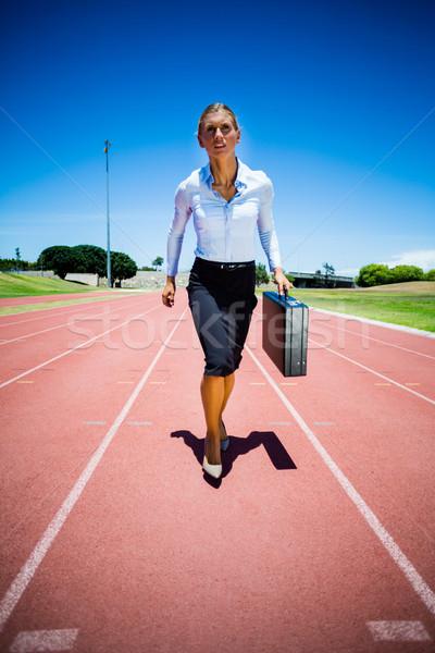 üzletasszony fut útvonal aktatáska üzlet nő Stock fotó © wavebreak_media
