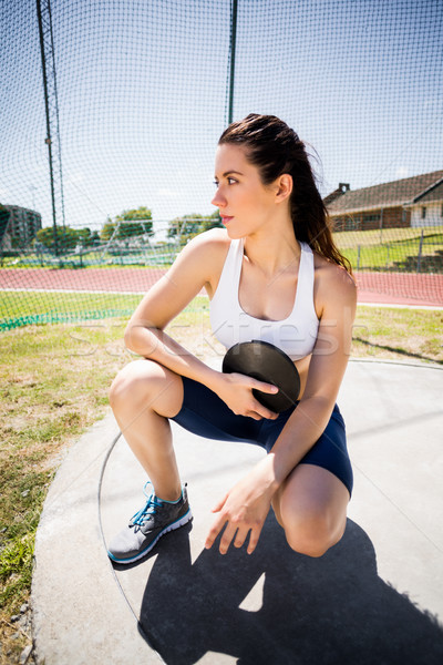 Confident female athlete holding a discus Stock photo © wavebreak_media