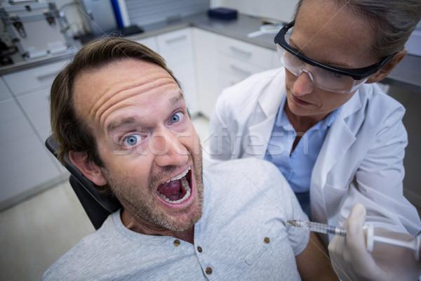Mannelijke patiënt bang tandheelkundige kliniek man Stockfoto © wavebreak_media