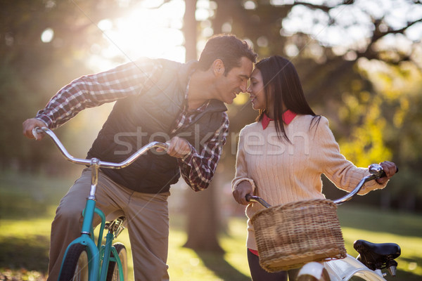 Stock photo: Romantic couple with bicycles at park