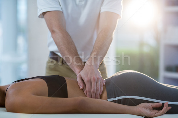 Male physiotherapist giving back massage to female patient Stock photo © wavebreak_media