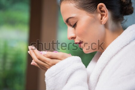 Woman smelling her cup of coffee with her eyes closed Stock photo © wavebreak_media