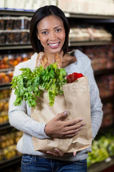 肖像 笑顔の女性 食料品 袋 スーパーマーケット ストックフォト © wavebreak_media