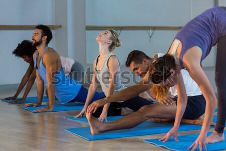Yoga istruttore aiutare studente correggere posa Foto d'archivio © wavebreak_media
