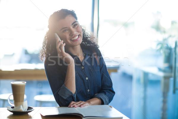 Smiling woman talking on mobile phone Stock photo © wavebreak_media
