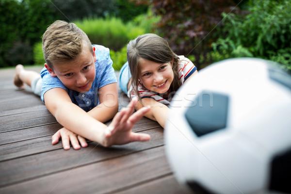 Ninos jugando fútbol nina feliz nino diversión Foto stock © wavebreak_media