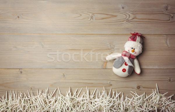 снеговик небольшой свечей деревянный стол Рождества время Сток-фото © wavebreak_media