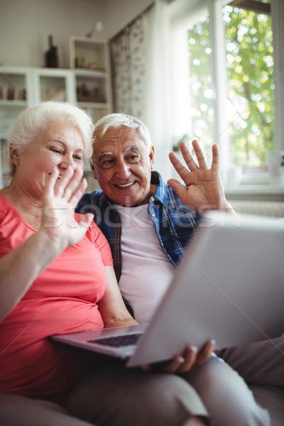 Idős pár videó beszélget laptop otthon férfi Stock fotó © wavebreak_media
