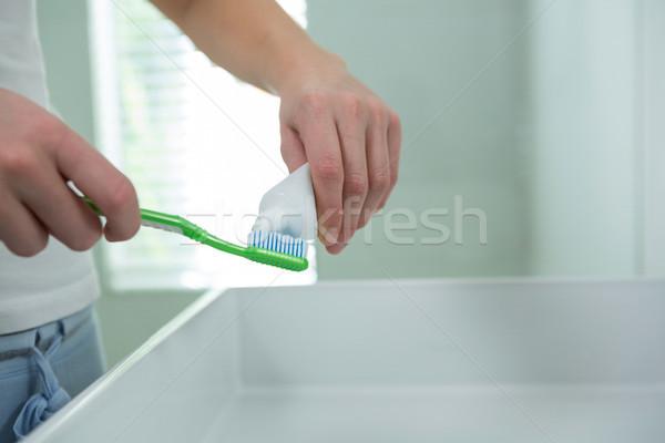 Kadın diş macunu fırçalamak banyo ev el Stok fotoğraf © wavebreak_media