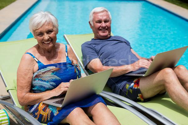 Portré idős pár laptopot használ társalgó szék számítógép Stock fotó © wavebreak_media