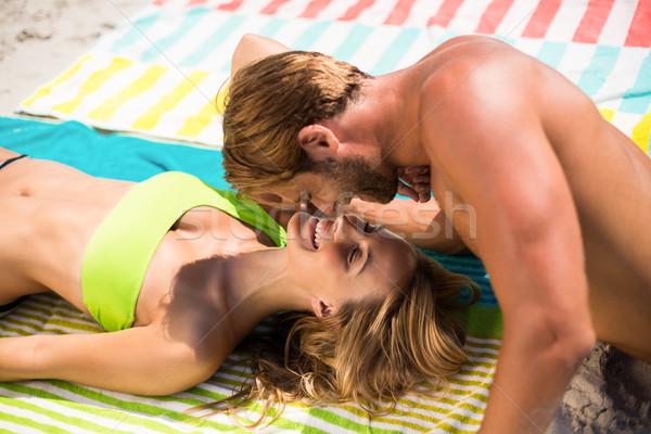 Young couple at beach on sunny day Stock photo © wavebreak_media